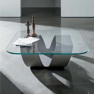 Table basse en verre soldes 4 pieds for Table verre design italien